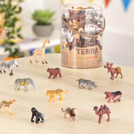 toy wild animals on wooden table.