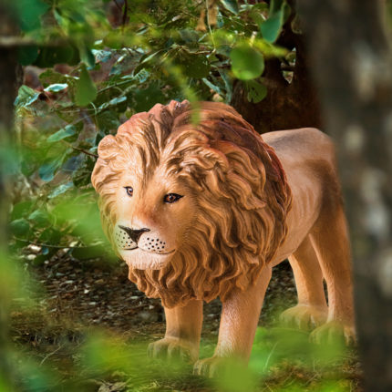 toy lion in a jungle